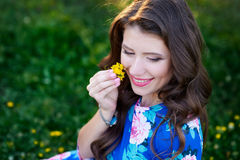 Beautiful young woman holding a flower Stock Photos