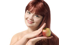 Beautiful young woman holding fresh apple Royalty Free Stock Images
