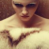Beautiful young woman holding furs Stock Photos