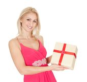 Beautiful young woman holding a gift box Royalty Free Stock Photos