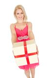 Beautiful young woman holding a gift box Royalty Free Stock Photography