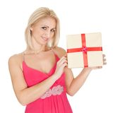 Beautiful young woman holding a gift box Royalty Free Stock Images