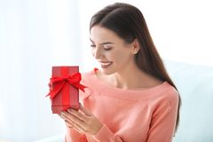 Beautiful young woman holding gift box Stock Photos