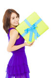 Beautiful young woman holding a gift box Stock Photos