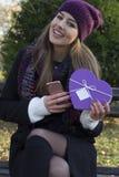 Beautiful young woman holding a gift. Beautiful young woman holds a gift in their hands Stock Photos