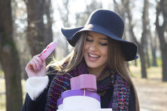 Beautiful young woman holding a gift. Beautiful young woman holds a gift in their hands, lens flare Royalty Free Stock Photo