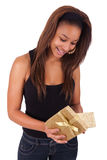 Beautiful young woman holding a gift, isolated on white Stock Image