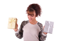 Beautiful young woman holding a gift, isolated on white Royalty Free Stock Photography