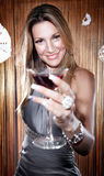 Beautiful young woman holding a glass of red wine Royalty Free Stock Photo