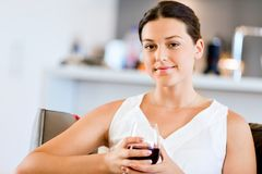Beautiful young woman holding glass with red wine Stock Photos