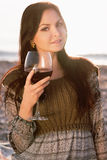 Beautiful young woman holding glass of red wine Royalty Free Stock Photography