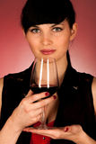 Beautiful young woman holding a glass of red wine Stock Photo