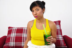 Beautiful young woman holding a glass Stock Photography