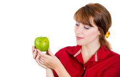 beautiful young woman holding a green apple Royalty Free Stock Photo