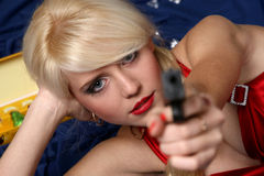 Beautiful young woman holding gun, focus on face Royalty Free Stock Images