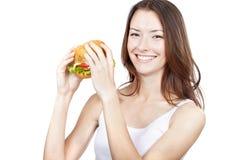 Beautiful young woman holding hamburger Stock Photo