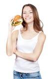 Beautiful young woman holding hamburger Stock Photos