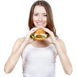 Beautiful young woman holding hamburger Royalty Free Stock Photos