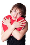 Beautiful young woman holding a heart Stock Photography