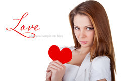 Beautiful young woman holding a heart Royalty Free Stock Photos