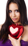 Beautiful young woman holding heart shape Royalty Free Stock Image