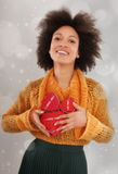 Beautiful young woman holding her gift box Stock Image