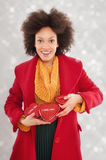 Beautiful young woman holding her gift box Stock Photography