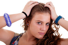 Beautiful young woman, holding her hair with hands Stock Photo