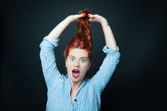 Beautiful young woman holding her hair up Stock Image
