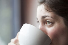 Beautiful Young Woman Holding Her Morning Cup of Coffee Stock Image