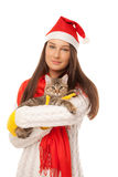Beautiful young woman holding a kitten on her hands Royalty Free Stock Image