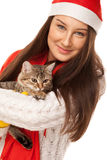Beautiful young woman holding a kitten on her hands Stock Images