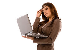 Beautiful young woman holding laptop. Multi Ethnic young woman holding laptop on pure white background stock image
