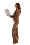 Beautiful young woman holding laptop Stock Photography