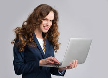 Beautiful young woman holding laptop Stock Photo