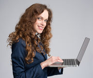 Beautiful young woman holding laptop Stock Images