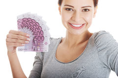 Beautiful young woman holding large sum of money. Stock Images
