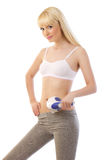 Beautiful young woman holding massager Stock Photography