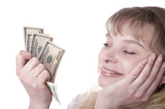 Beautiful young woman holding money Royalty Free Stock Photo