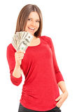Beautiful young woman holding money Royalty Free Stock Photos
