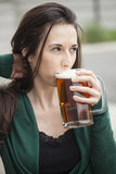 Beautiful Young Woman Holding Mug of Beer Stock Photography