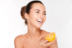 Beautiful young woman holding orange Stock Image