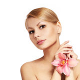 Beautiful young woman holding orchid flower, isolated Stock Images