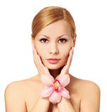Beautiful young woman holding orchid flower, isolated Royalty Free Stock Photo