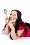 Beautiful young woman holding paintbrush Stock Photography
