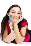 Beautiful young woman holding paintbrush Royalty Free Stock Photos