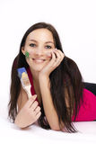 Beautiful young woman holding paintbrush Royalty Free Stock Photography