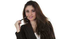 Beautiful young woman holding a pen Royalty Free Stock Photos