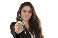 Beautiful young woman holding a pen Stock Photo