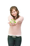 Beautiful young woman holding plant Royalty Free Stock Photography